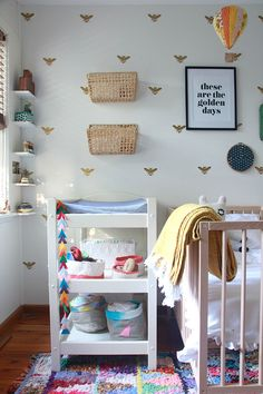 Bee-themed nursery with lots of baskets for storage
