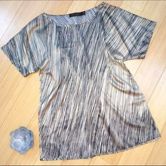 SALE!! The LIMITED blouse, M. So pretty tan and black short sleeve blouse from the Limited, size medium. This is a poly spandex blend, that feels just like silk. Great for the office. The Limited Tops Blouses