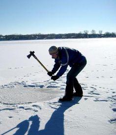Bryan Bolger, chopping hole in the ice for polar bear plunge.  mukluks.com
