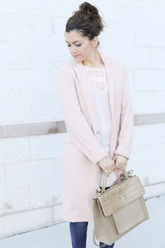 spring outfit with a blush overcoat, lace top, beige bag and heels