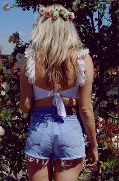Pack this outfit: Flower crown, light jean daisy duke, ruffle blouse in closet