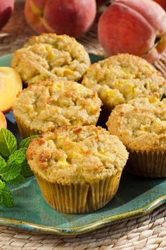 I love the chunks of peaches baked into theses fresh peach paleo muffins. The flavor of the peaches is wonderful with almond, honey and lemon. | cookeatpaleo.com