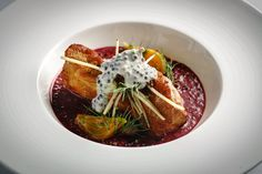 Monkfish cooked in hot wood smoke, served with freekeh and other grains cooked in reduced beet juice. Fowler & Wells,  Tom Colicchio's  restaurant. The Beekman hotel. Pic 7 in slideshow. NY Times
