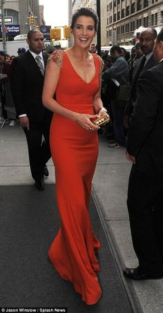 Picture of elegance: The film¿s Agent Maria Hill, played by Cobie Smulders, emerged from their accommodation in a red maxi gown