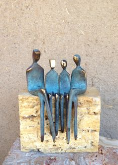 F A M I L Y - O F - 4.... , small bronze sculpture, family portrait, of boy and girl exchangeable by Yenny Cocq