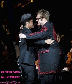 Bruno Mars Huggin Sir Elton John by GlacePR, via Flickr