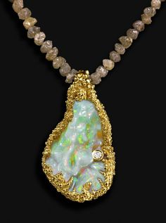 "Pendant: ""The Blue Nile Falls"" made with a 20 cts hand-carved Wello opals set in 18k gold with a brilliant cut diamond, and mounted on rough diamonds (42cts). Unique Piece. Via Ornella Iannuzzi."