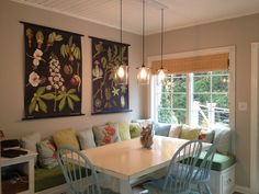 I love everything about this kitchen!!!!  Botanical prints, nook, painted chairs, window and lighting