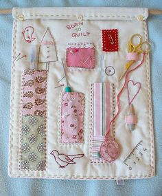 Sew & Stitch wall hanger by designedbynora