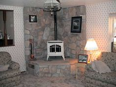 I like the high hearth this stove is sitting on.  I would like a mantle behind it, as well.