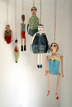 Ceramic marionette mobile by AnnaLela; something similar could be made with paper