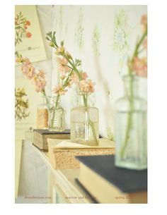 Flowers in vintage bottles. Cute way to decorate around the house!