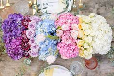 This rainbow of flowers arranged together makes a beautiful wedding table centerpiece.