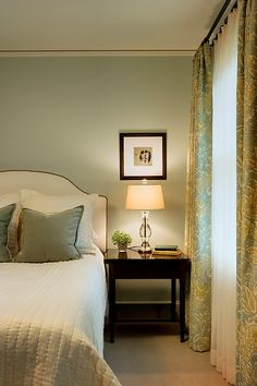 Love the color combinations in this bedroom. The studded headboard is a great idea