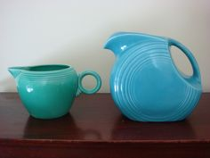 Turquoise pitcher and green creamer fiestaware