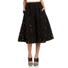 The midi skirt is the hottest silhouette of the season. Figure-flattering and feminine, Sams Girls love it with a solid crop top and pointy-toe pumps. Material: 100% nylonLining: 100% acetateCare Instruction: hand wash cold, dry flat.Length: 29 in (taken from size small/4)