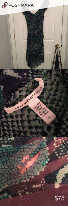 "Diane Von Furstenberg ""Gertrude"" Dress 100% silk, cap sleeved, blue/green snake skin dress. Slight damage at the bottom of the back of the dress, not noticeable. Diane von Furstenberg Dresses Midi"