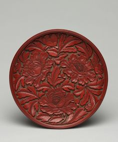 Plate with Peony Decoration, late 14th-early 15th Century  China, Yuan dynasty (1271-1368)  carved cinnabar lacquer on wood, Diameter - w:16.50 cm