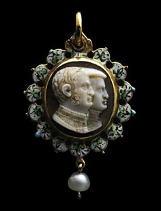 Onyx cameo double portrait busts of a man and a woman side, facing in profile towards the right, The oval gold frame is enclosed within a green, white and black border of ivy leaves and the back is enameled with the arms of the husband impaling those of the wife, with the date 1314 below. Hanging pearl. Formerly Esmerian collection. Cameo: German, c.1640, setting 17th century.