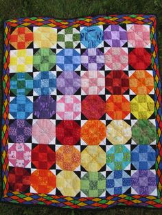 Handmade Hand quilted Baby quilt Rainbow Hugs :  Baby or lap quilt. $125.00, via Etsy.