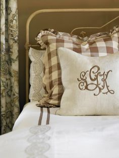 pillow monogramming and pleated flanges and embroidered linens