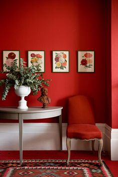 Red on red brings an edge into a space and makes the lighter elements, like the botanical wall art and patterned rug become the featured elements in the space.