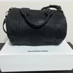 Alexander Wang Rocco Never used. Comes with dust bag and box. I DO NOT TRADE. Made of lamb skin. Authentic. New with tags. Hardware is black. Alexander Wang Bags