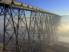 The Lethbridge Viaduct is the largest railway structure in Canada, standing almost 100 meters high and over 1,600 meters long. This morning it appeared to be skirted in a morning fog.