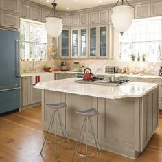 I love pale grey wood cupboards - I would do a dark grey island. Eat in counter, floor to ceiling cupboards - beautiful!