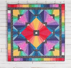"""Tula Pink's """"True Colors"""" shine in the Prism Quilt Kit! You'll receive a pattern and radiant fabric from the True Colors collection to sew this stunning quilt top. Featuring a dazzling, dimensional design and the luscious hues and prints you except from Tula, this project is a wall-worthy find."""