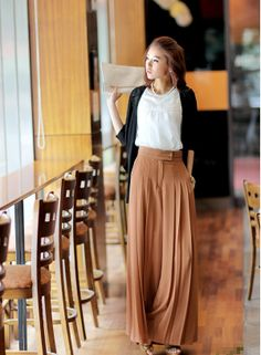 Light Brown Pleats | A pleated skirt can be very flattering to all body types because it glides with the body. Here is some inspiration.