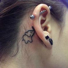 Simple Elephant Outline Tattoo - Small Elephant Tattoo - Ear Tattoo - The Best Elephant Tattoo Designs - Cute Elephant Tattoo Designs and Ideas - Sexy Thigh Tattoo, Small Elephant Tattoo, Elephant Outline, Elephant Tattoo Meanings Little Elephant Tattoos, Elephant Head Tattoo, Simple Elephant Tattoo, Elephant Tattoo Meaning, Elephant Tattoo Design, Hippo Tattoo, Tiger Tattoo, Trendy Tattoos, Small Tattoos