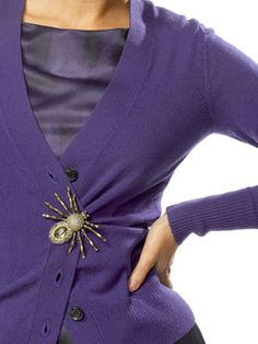 It may sound simple, but these are nice ideas for how to wear a brooch. :-)  I especially love this one: to close a cardigan!