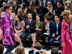 An equally captivating sight unfolds beyond the Burberry catwalk, where Victoria Pendleton, Aaron Paul, Dita Von Teese, One Direction's Harry Styles and Dev Patel score front row seats Monday to see the label's Spring/Summer 2013 women's wear collection at London Fashion Week.