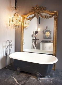 Antique bathtub, mirror, gold, marble floor tiles, chandelier, bathroom, interior, vintage