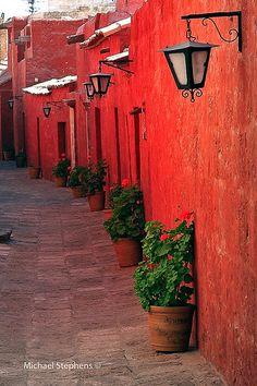 Red plaster walled street in Santa Catalina Monastery, Arequipa, Peru