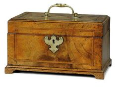 A GEORGE II WALNUT TEA CADDY  CIRCA 1740  With brass mounts and hinged lid  9¼ in. (24 cm.) wide