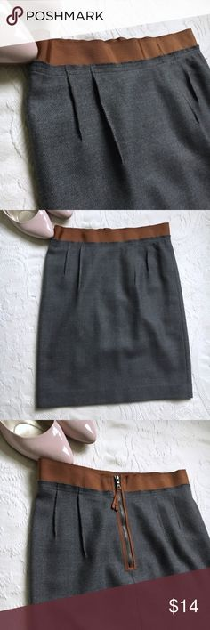 """PRICE DROP! LOFT Wool Skirt w/ Zipper Detail Workwear just got cooler with this fresh gray wool blend skirt. Amazing details: rough seaming, glossy brown ribbon waistband, and exposed zipper with ribbon accents. Some pilling and wear on the back right panel, visible up close but totally wearable (pictured). Fully lined. Approximately 19"""" total length. Wool/nylon/acetate. Size: 0P. LOFT Skirts"""