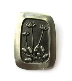 SOLD. R Tennesmed floral pewter brooch, flower design, Rune Tennesmed, modernist Sweden, Scandinavian design, 1970s midmod design, R Tenn. https://www.etsy.com/uk/listing/465038360/r-tennesmed-floral-pewter-brooch-flower