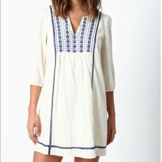 NWT White and Blue Peasant Dress White and blue flowy peasant dress. New with Tags. Size M. Built in slip underneath so not at all see through. Love Culture Dresses Midi