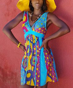 A flurry of patterns and mingling colors bedeck this frock. An empire-waist and a surplice neckline create a summer-inspired look to love.100% cottonMachine washImported
