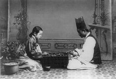 Korean players, in traditional dress, play in a photograph dated between 1910 and 1920.