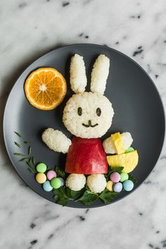 Easy Easter Bunny Food Art - made with rice, an apple, sushi seaweed, parsley, an egg, and M&M's! by @healthynibs