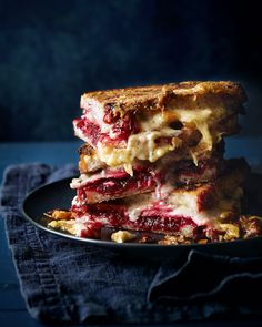 A comfort food favourite; this oozing toastie tower of wonder – made with cheese, ham and a homemade beetroot chutney – is snack time royalty. Serve it hot, straight from the oven, to appreciate all its cheesy goodness. Cheese Toasties, Ham And Cheese Toastie, Toast Sandwich, Sandwich Board, Good Food, Yummy Food, Healthy Food, Tasty, Delicious Magazine