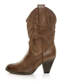 i love a good pair of worn in cowboy boots with a white lace or linen dress.