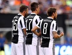 Andrea Barzagli #15,Mario Mandzukic #17 and Claudio Marchisio #8 of Juventus line up in front of their goal in the first half against Barcelona during the International Champions Cup 2017  on July 22, 2017 at MetLife Stadium in East Rutherford, New Jersey.