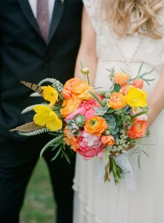 Bright and textured bouquet. I'd nix the feathers.