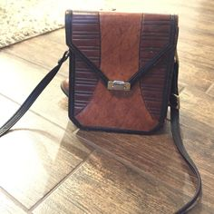Great vintage leather crossbody bag Unsure of the designer. Great bag. Has some signs of wear in the leather on the bottom and the front. Bags Crossbody Bags