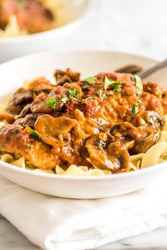 This Easy Chicken Cacciatore is boneless, skinless chicken thighs and mushrooms simmered in a rich tomato sauce and served over a bed of egg noodles for a fabulous weeknight meal.   Easy Dinners   Easy Pasta   Chicken Pasta  