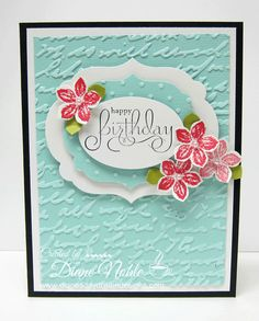 Stamp the script background and emboss with clear...then the die cuts/flowers on raised stickies